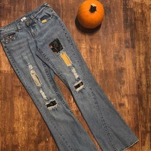 Cache distressed jeans with patchwork